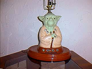 Yoda light up lamp attached to a lamp